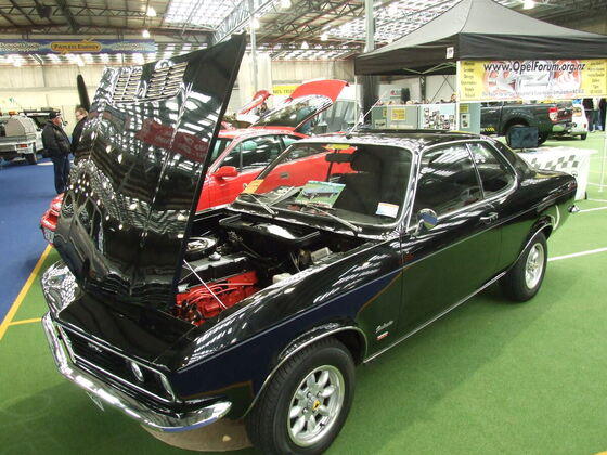 Opel Manta A on club stand in Dunedin, NZ - note chrome bumpers rather than US spec! ;)